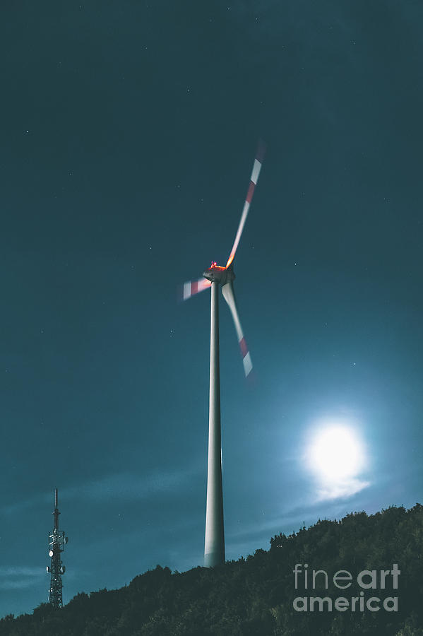 A Wind Turbine On A Full Moon Night Photograph by Michael Bohnen