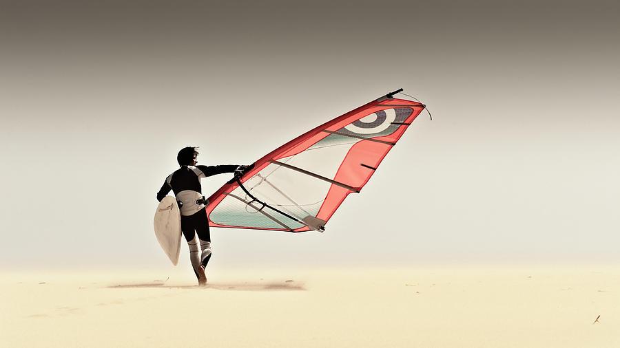 A Windsurfer Runs On The Sand Of Punta Photograph by Ben Welsh / Design Pics