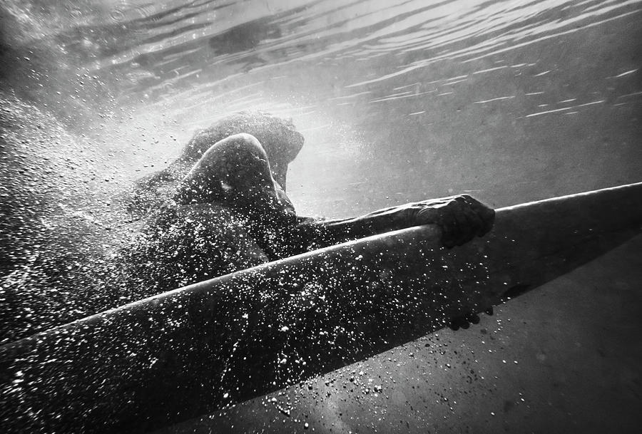 A Woman On A Surfboard Under The Water Photograph by Ben Welsh / Design Pics