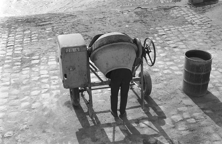 A Worker Cleans A Cement Mixer Photograph by Keystone-france