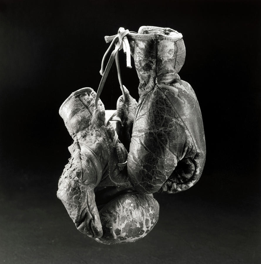 A Worn Boxing Gloves Photograph by Henri Silberman