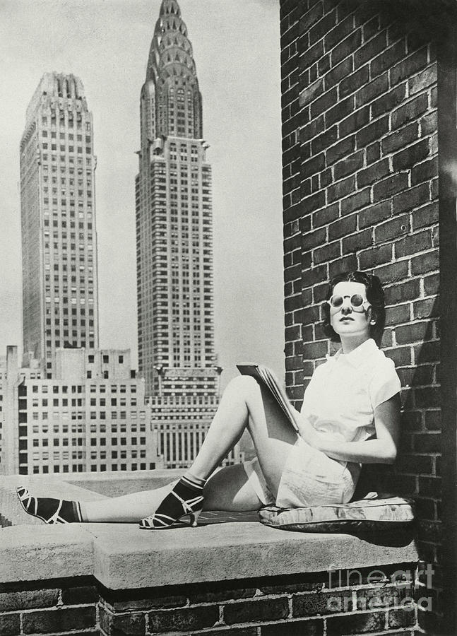 A young woman sunbathing on the roof  by Unknown