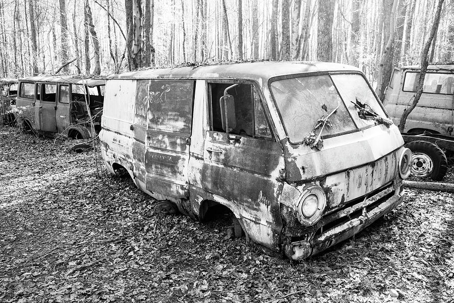 Abandoned Van in a Junkyard in the Woods by Keith Dotson
