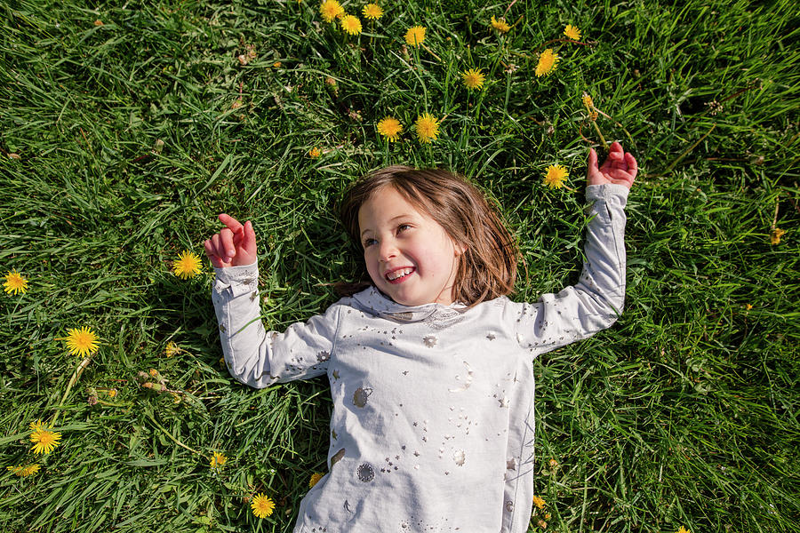 Above-view Of A Happy Smiling Child Laying In A Field Of ...