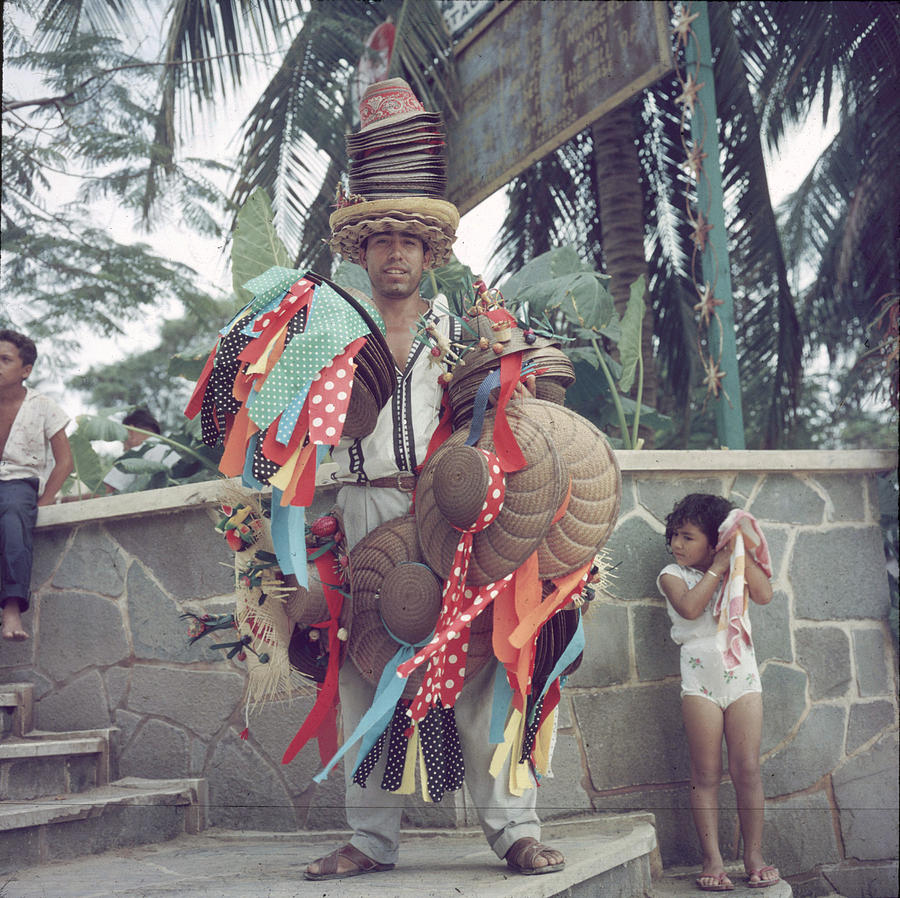 Acapulco Hat Seller Photograph by Slim Aarons