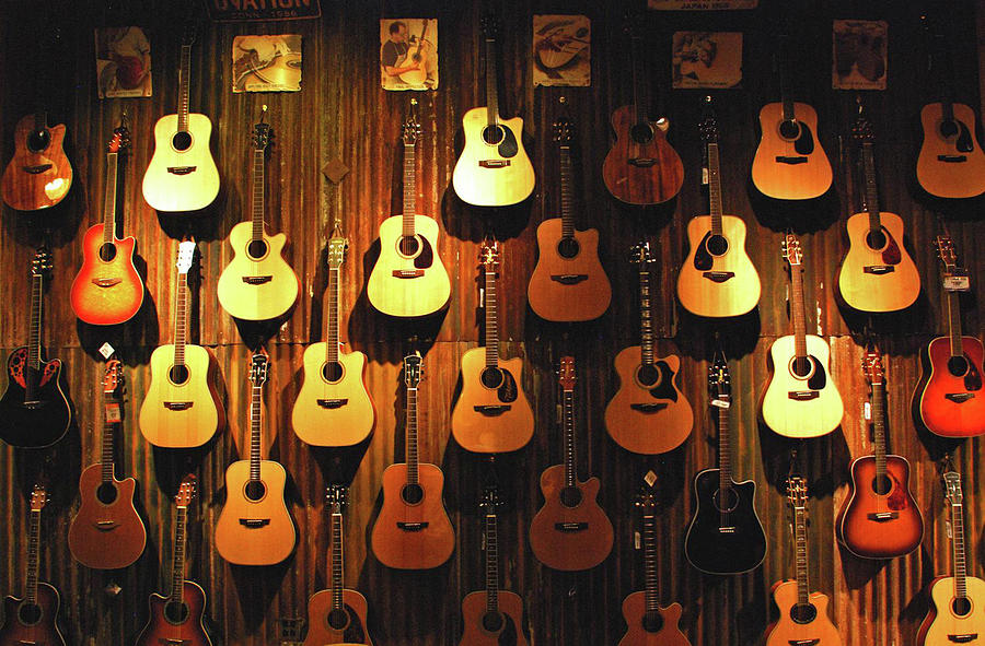 Acoustic Guitars On A Wall Photograph by Karas Cahill Photography