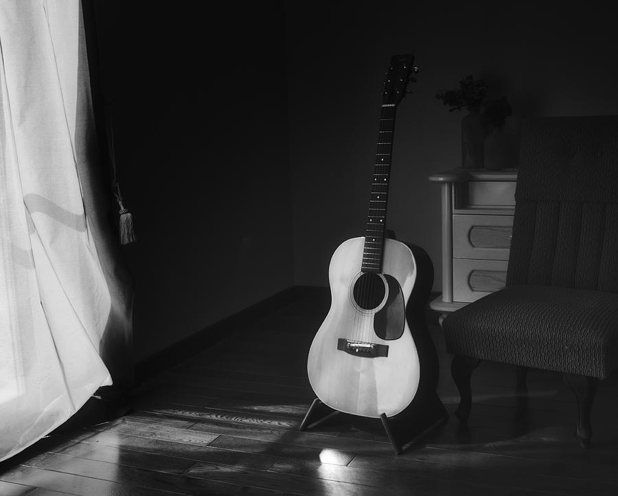 Acoustic Spanish Guitar On A Stand In The Moody Shadows Of A Dark Room With Light From A Curtain Photograph By Tennessee Witney