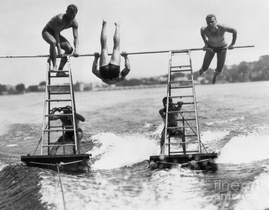 Acrobats On Lake Photograph by Bettmann