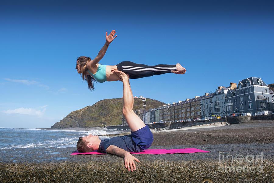 Aberystwyth Photograph - Acroyoga On Aberystwyth Beach by Keith Morris
