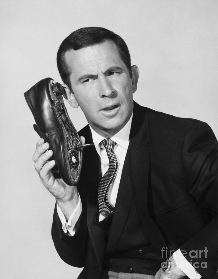 Actor Don Adams With Shoe-phone Photograph by Bettmann