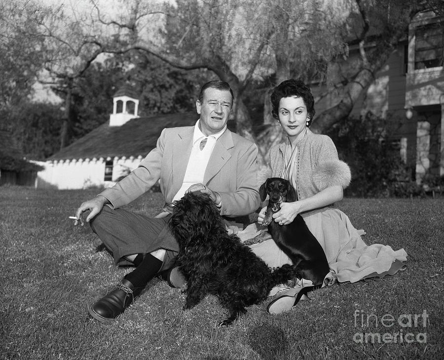 Actor John Wayne And Wife Pilar Wayne Photograph by Bettmann