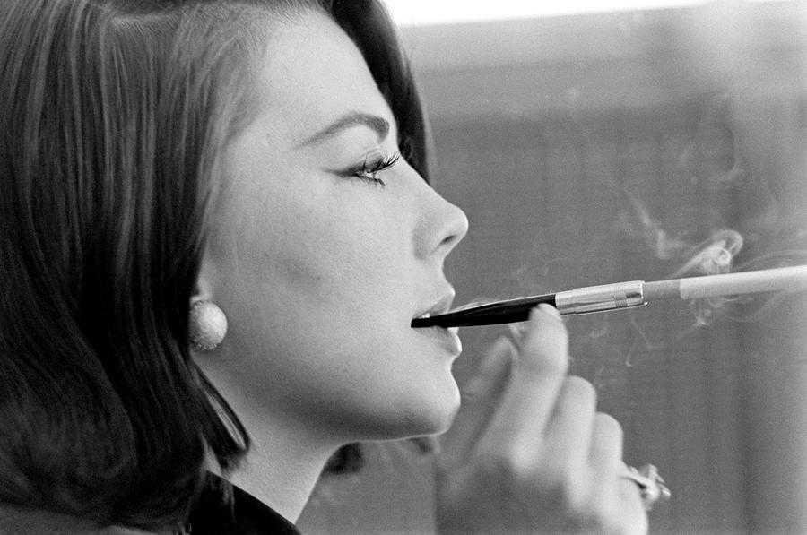 Actor Natalie Wood Lights Up A Photograph by John Dominis