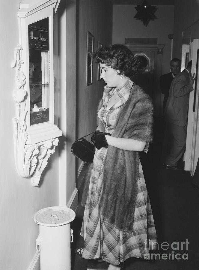 Actress Elizabeth Taylor Pausing Photograph by Bettmann