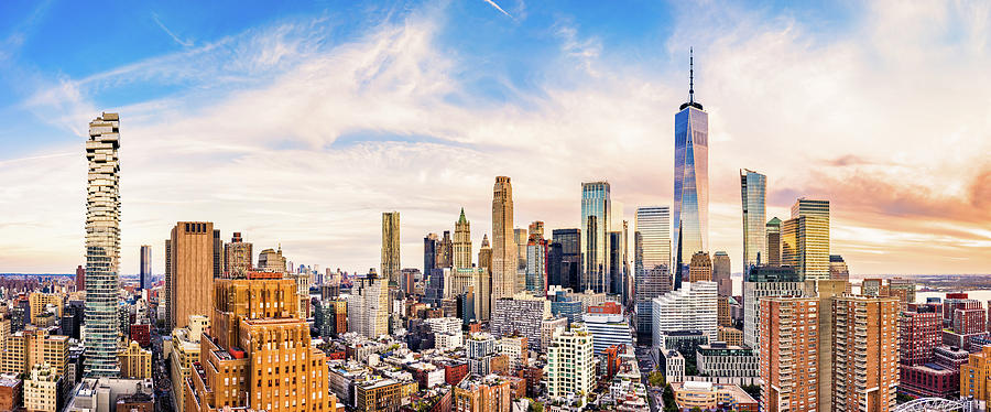 Aerial panorama of Lower Manhattan skyline at sunset by Mihai Andritoiu