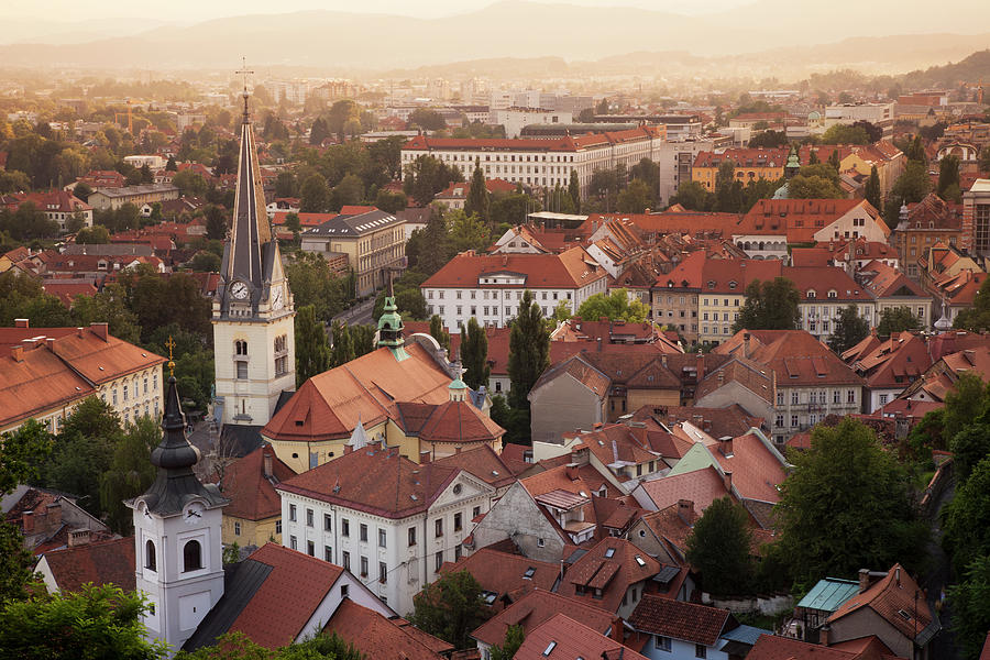 Scenic Photograph - Aerial View Of Church And Rooftops by Cultura Rf/lost Horizon Images