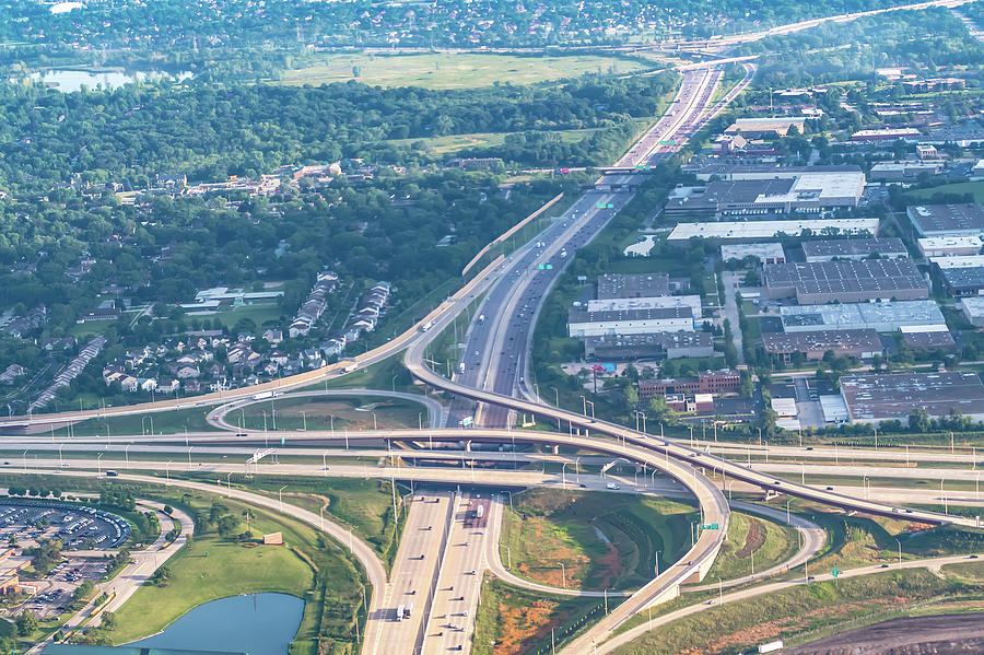 Aerial view of highway interchange in a city by ALEX GRICHENKO