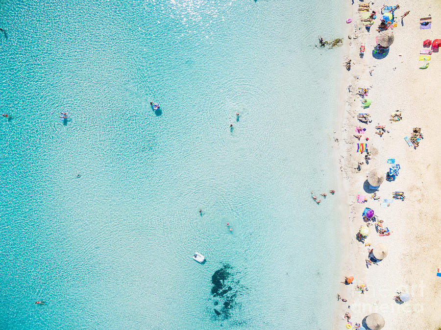 Parasol Photograph - Aerial View Of Sandy Beach With by Paul Prescott