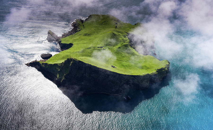 Aerial view of small island in Iceland by Suranga Weeratunga