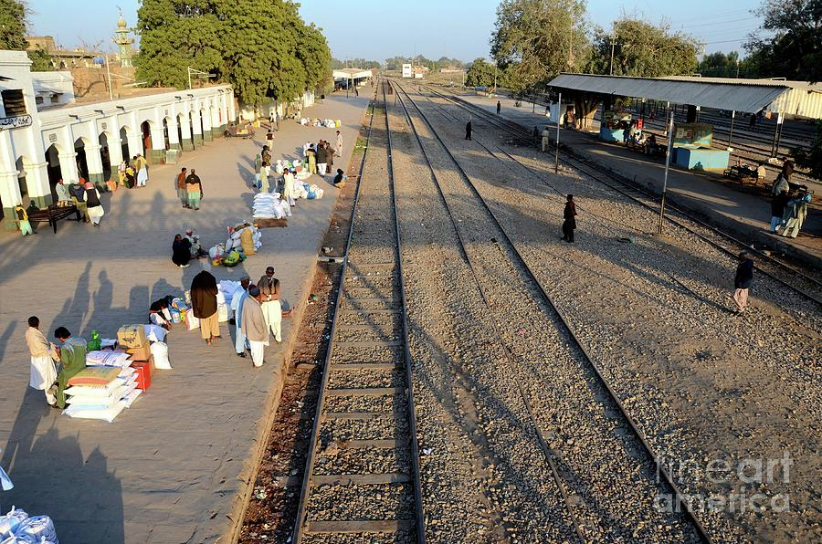 Aerial view of travelers and traders with goods Mirpurkhas railway station platform Sindh Pakistan by Imran Ahmed