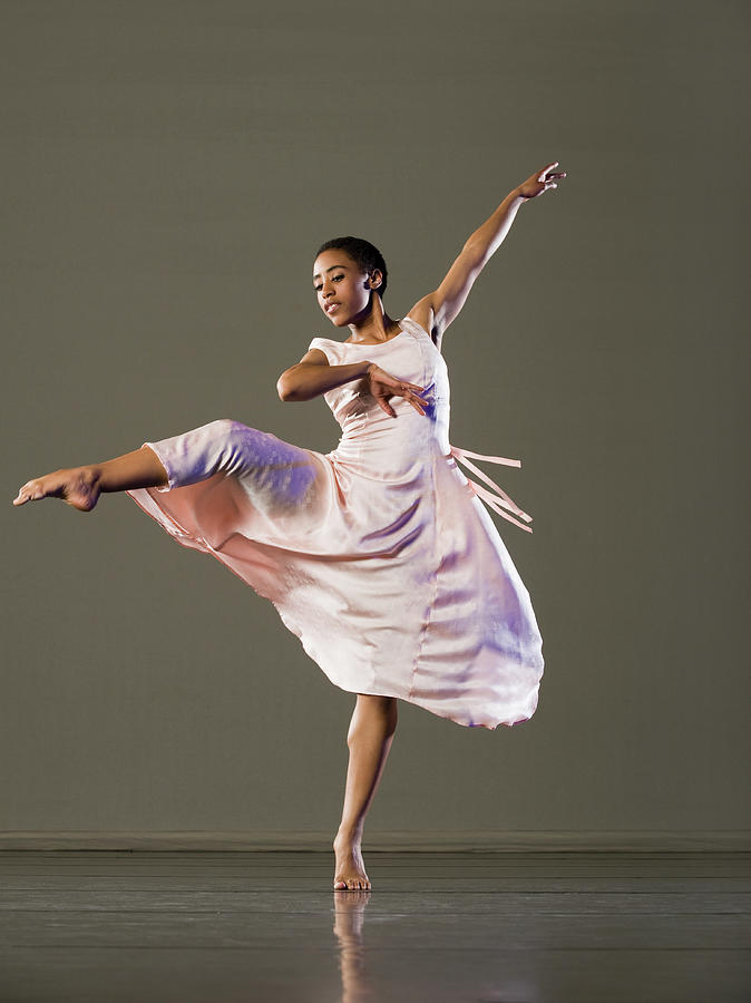 African Female Ballet Dancer Dancing Photograph by Erik Isakson