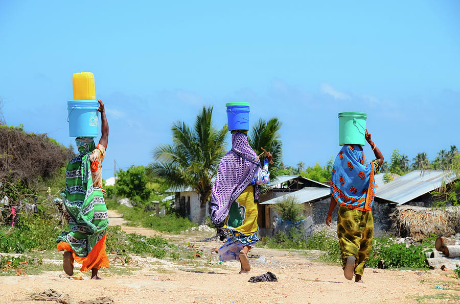 African Women Go To Fetch Water W Photograph by Volanthevist