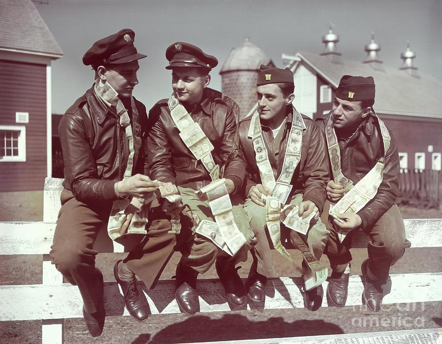 Air Force Gunners Comparing Short Photograph by Bettmann