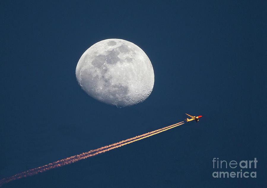 Airliner and Waxing Gibbous Moon by Kevin McCarthy