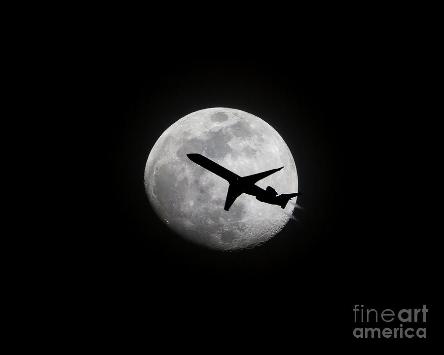 Airliner Passing in Front of a Full Moon by Kevin McCarthy