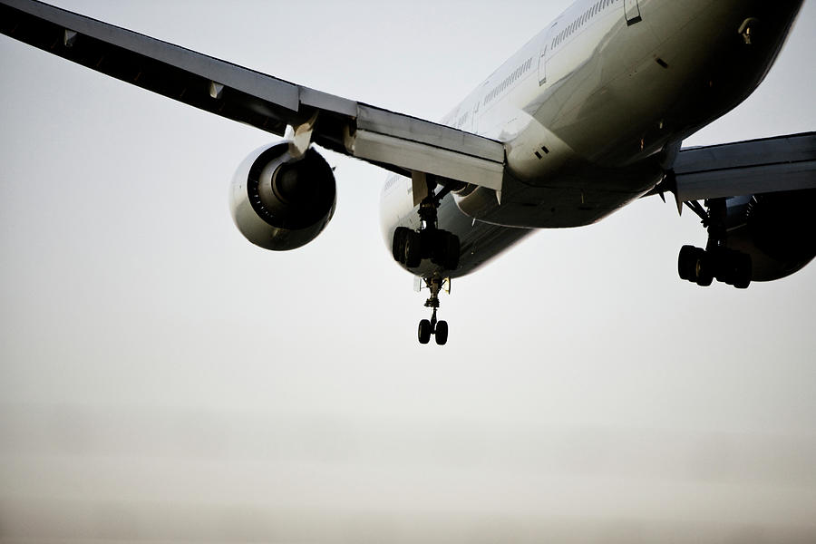 Airplane Landing At An Airport Photograph by Win-initiative