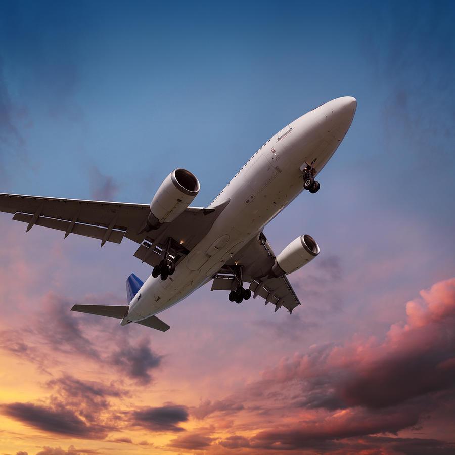 Airplane Landing In Sunset Light Photograph by Narvikk