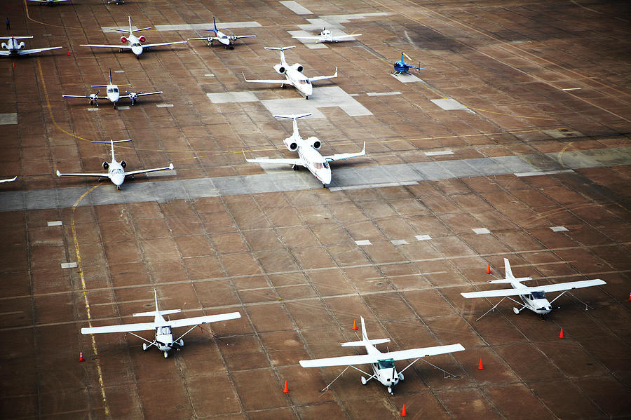 Airplanes On Tarmac Photograph by Thomas Northcut