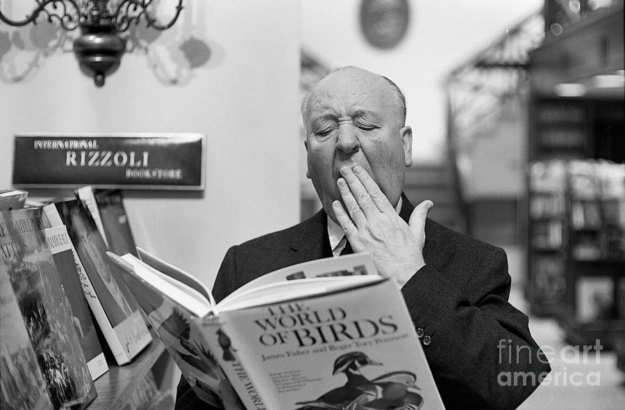 Alfred Hitchcock Yawning Over Book Photograph by Bettmann