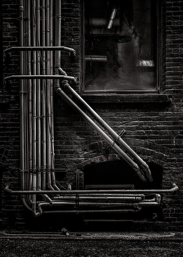 Brian Carson Photograph - Alleyway Pipes No 2 by Brian Carson