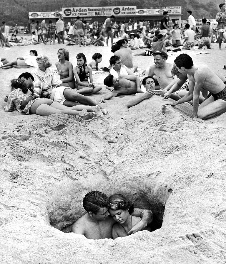 Alone On A Crowded Beach Photograph by Ralph Crane