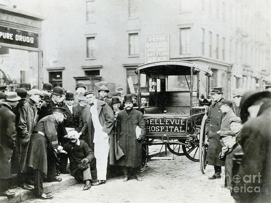 Ambulance Idling By Crowd Photograph by Bettmann