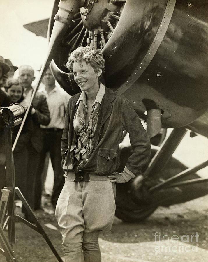 Amelia Earhart Beside Her Plane Photograph by Bettmann