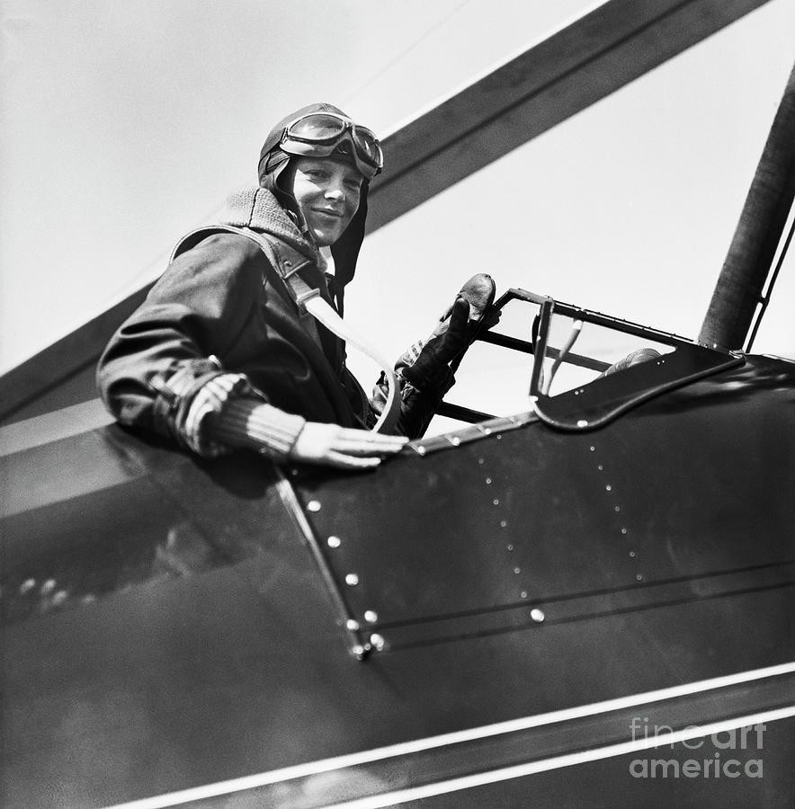 Amelia Earhart In Airplane Cockpit Photograph by Bettmann