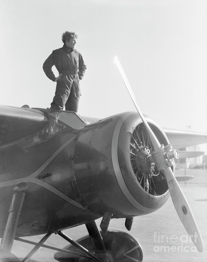 Amelia Earhart Standing Atop Plane Photograph by Bettmann