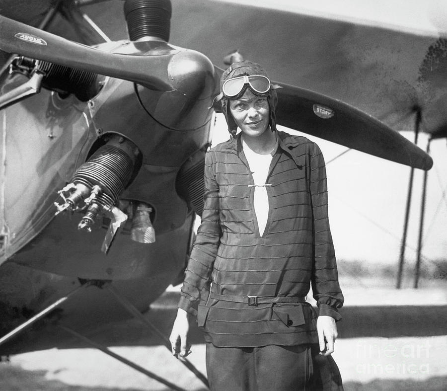 Amelia Earhart Stands In Front Of Plane Photograph by Bettmann