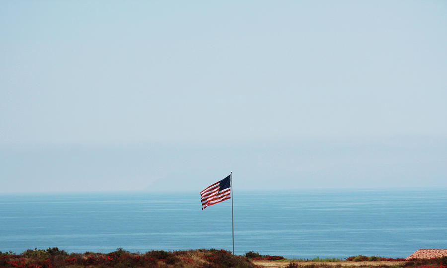 American Flag Along The Coast Of Photograph by Amanda Bolland