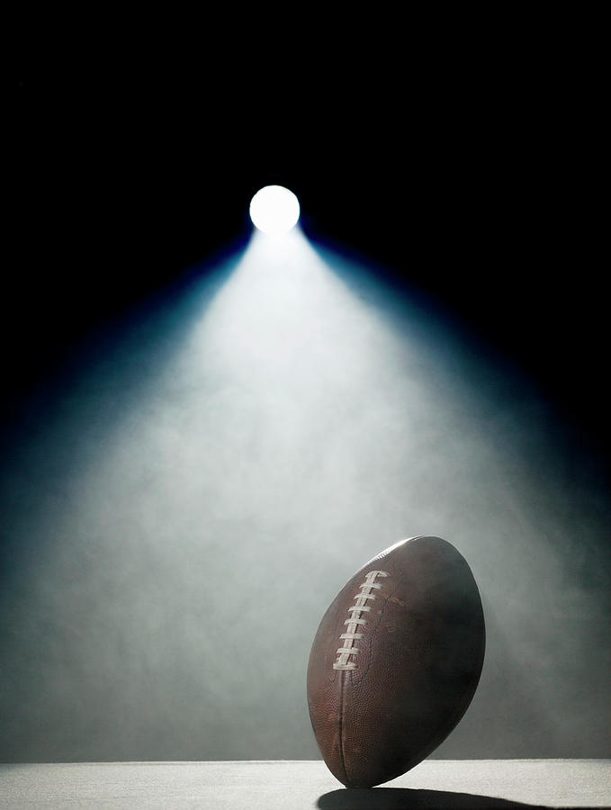 American Football In Spotlight Photograph by Siri Stafford
