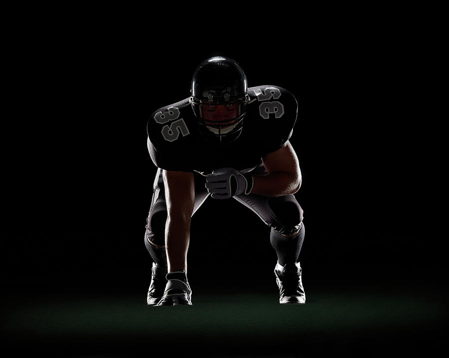 American Football Player In 3-point Photograph by Lewis Mulatero