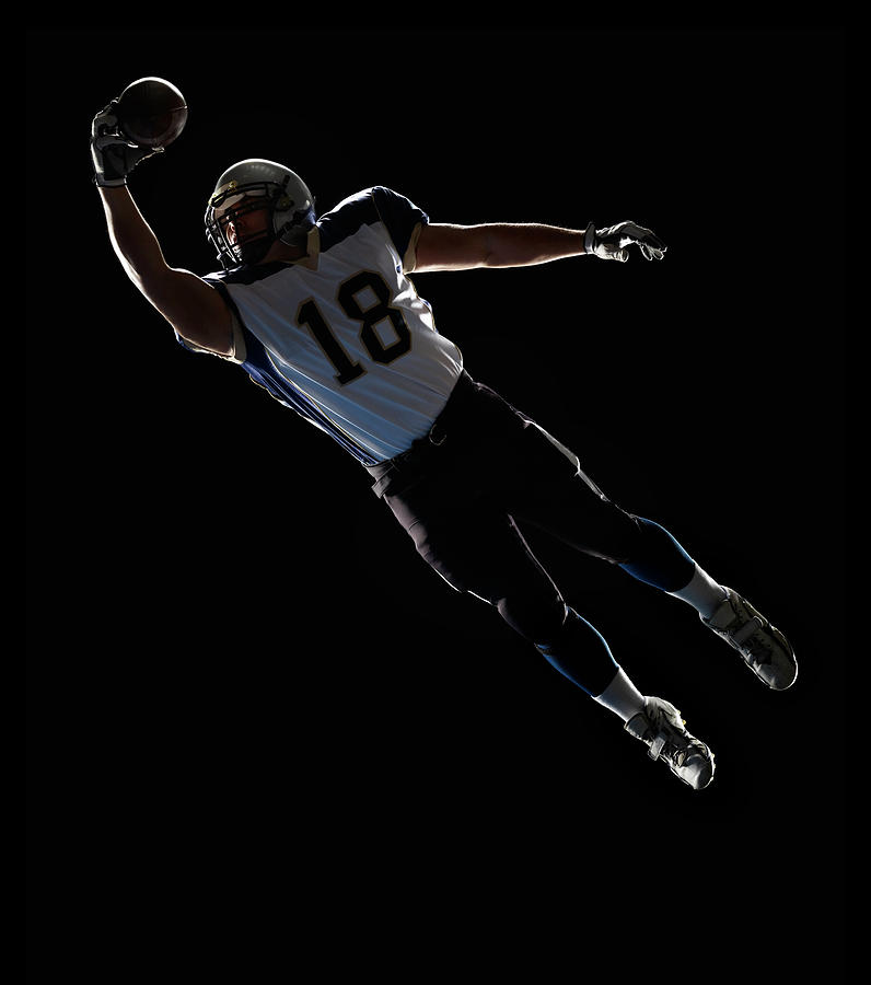 American Football Player Leaping To Photograph by Lewis Mulatero