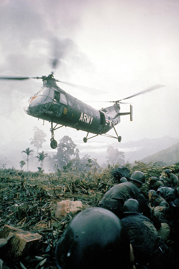 American Helicopter H-21 Hovering Above Photograph by Larry Burrows