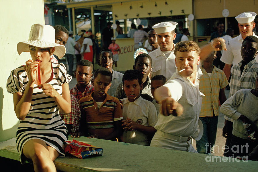 Charlotte Amalie Photograph - American Sailors Play Carnival Games At A Transfer Day Festival. by James L Stanfield