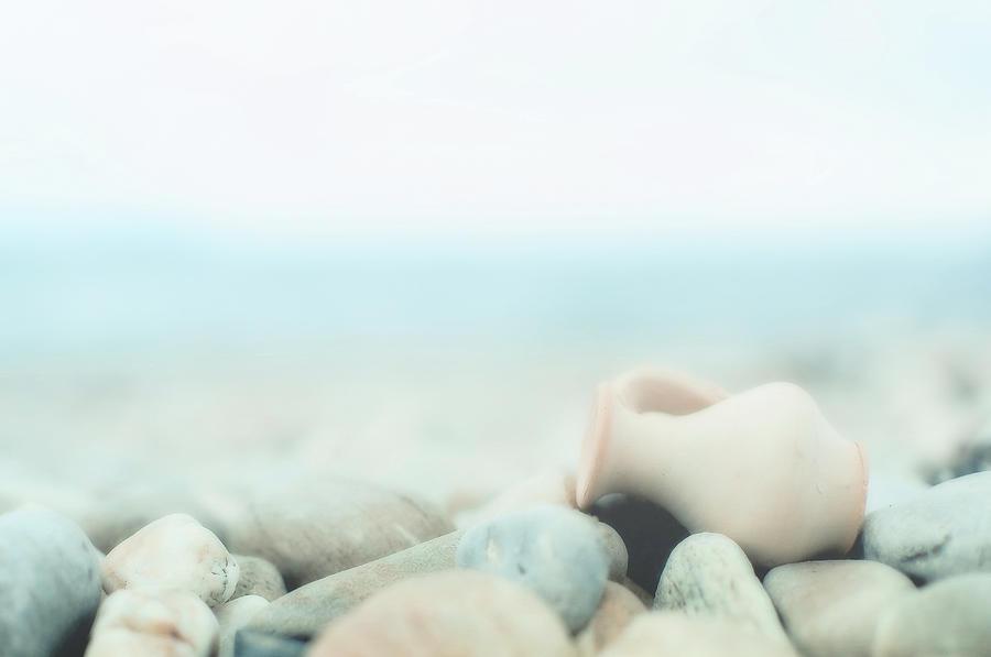 Amphora Lies On Pebbles Photograph by Alexandre Fp
