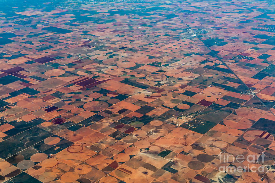 Plane Photograph - An Aerial View Of Massive Farmland With by Richard A Mcmillin