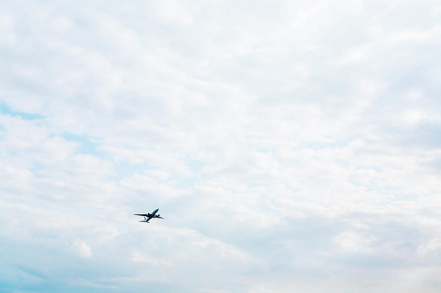 An Air Plane Flying In The Sky Photograph by Kohei Hara