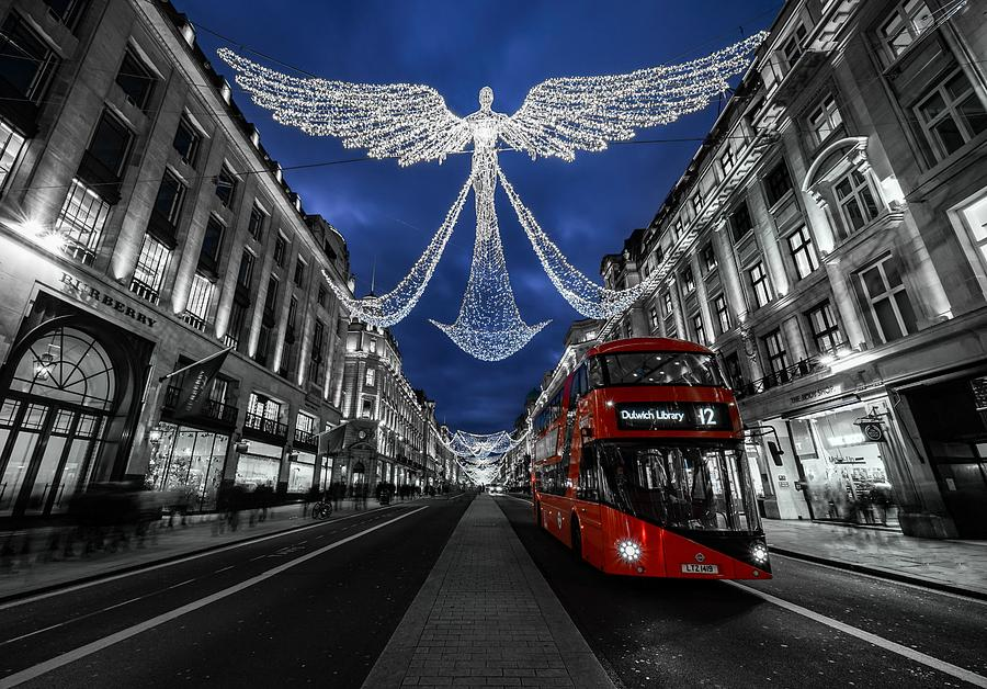 An Angel Christmas Decoration And A Red Bus In London, England. Photograph