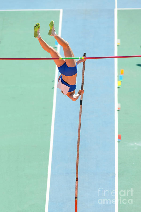 Woman Photograph - An Athlete Attempts Successful A Pole by Maxisport